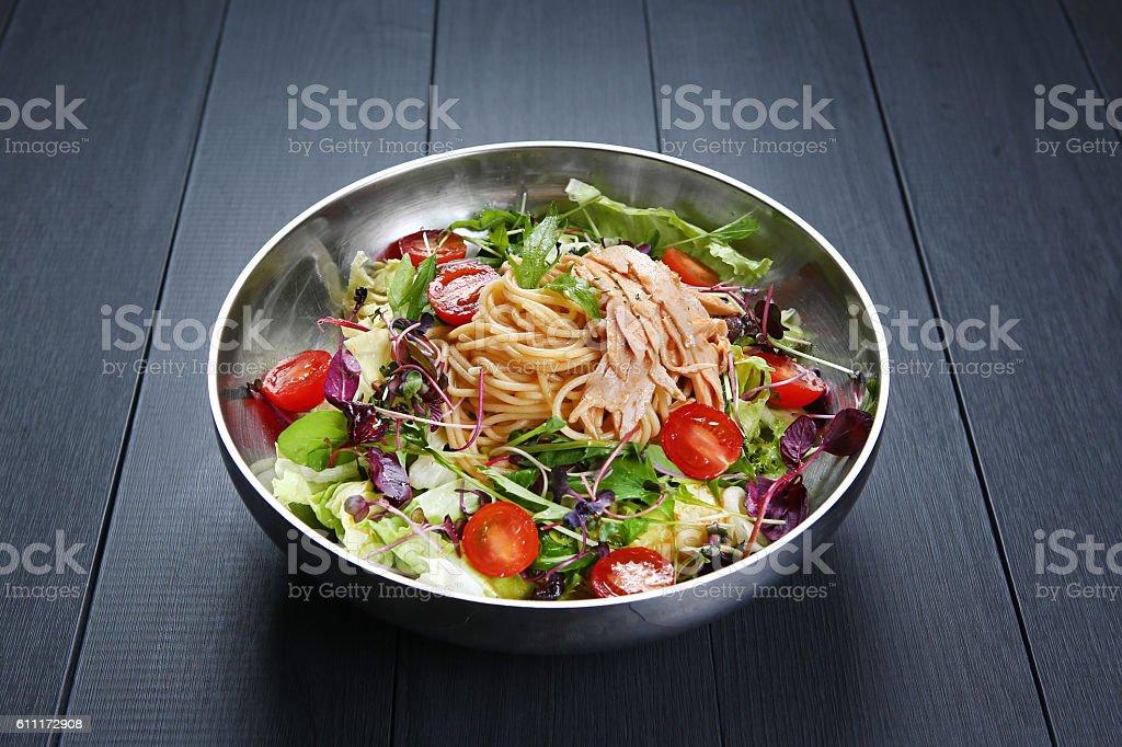 Chichen salad Pasta with spaghetti, tomato and herbs in bowl stock photo