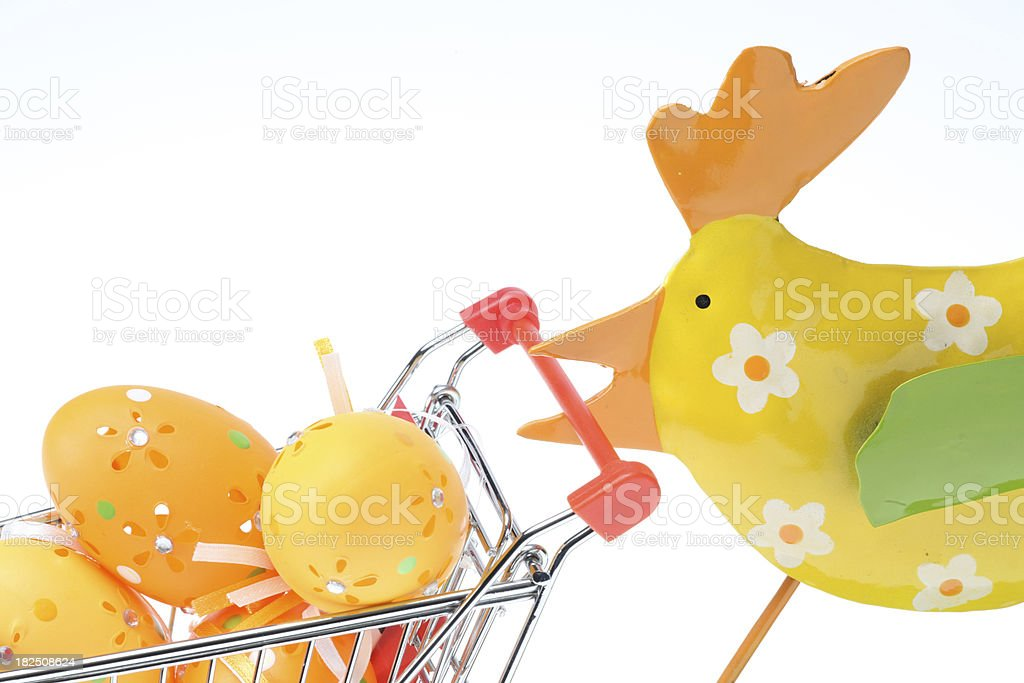 Chick and shopping cart filled with easter eggs royalty-free stock photo