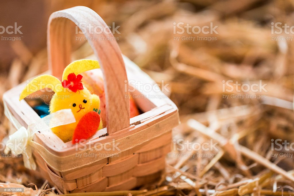 Chick in a Whicker Basket Easter Decoration stock photo