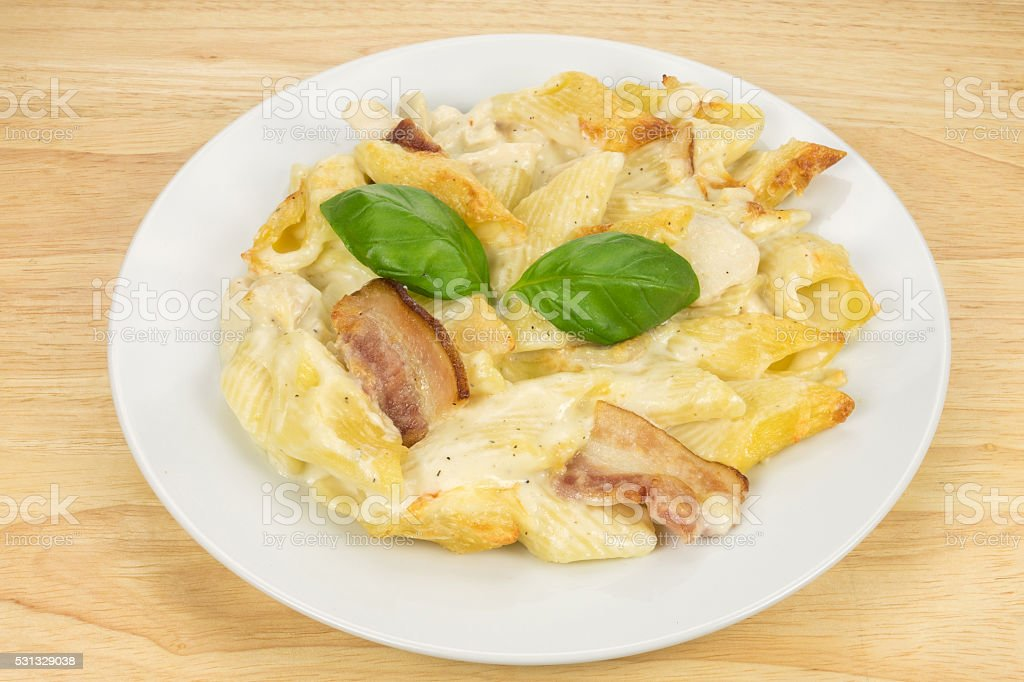 Chicken and bacon pasta bake meal stock photo