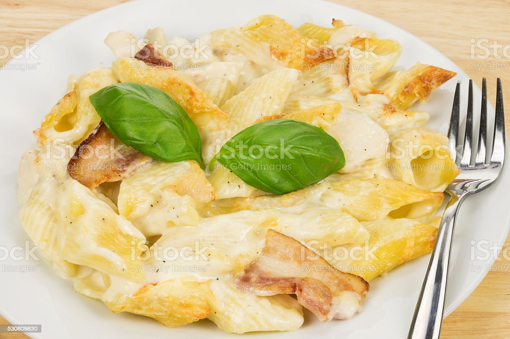 Chicken and bacon pasta TV dinner stock photo