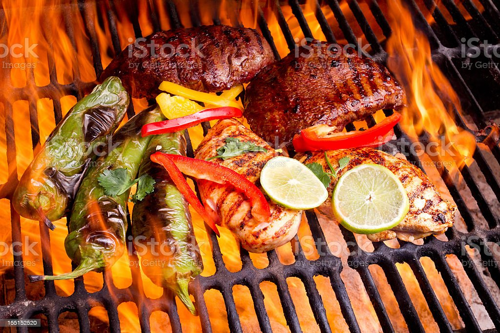Chicken and Beef Fajitas with flames stock photo
