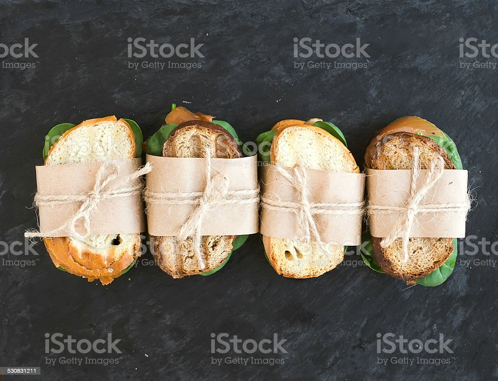 Chicken and spinach sandwiches wrapped stock photo