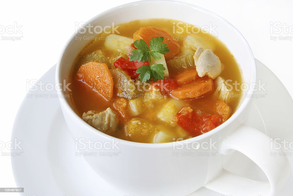 Chicken and vegetable soup in a teacup stock photo