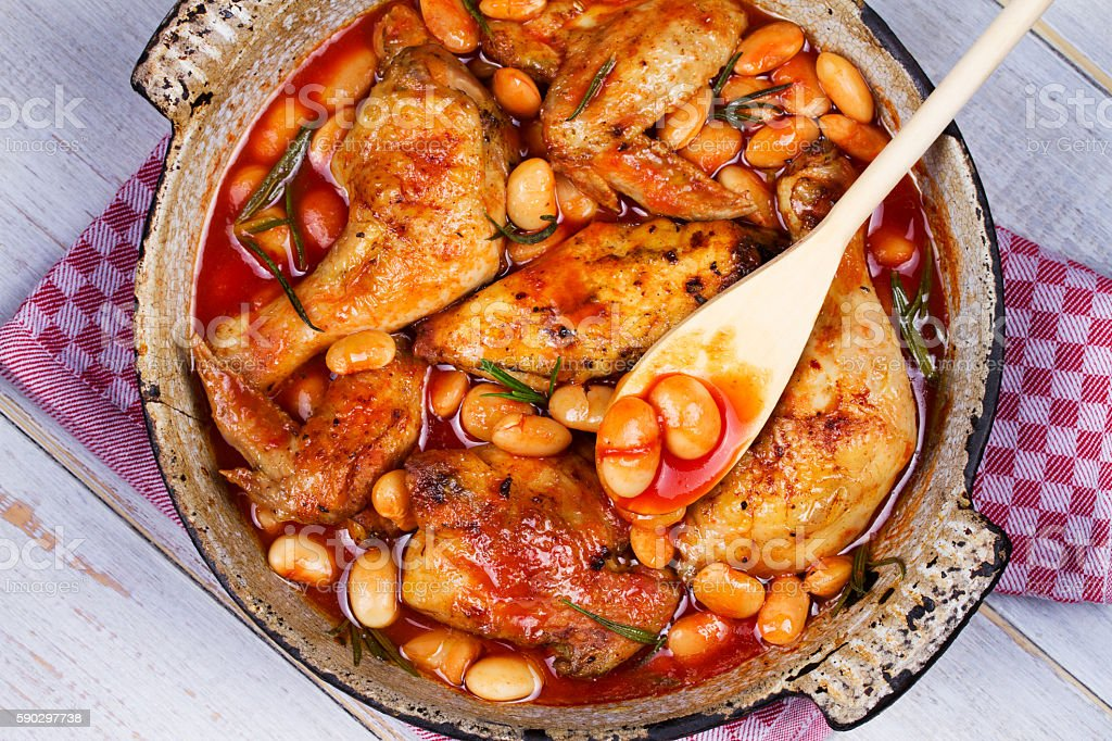 Chicken and white bean in tomato sauce with rosemary stock photo