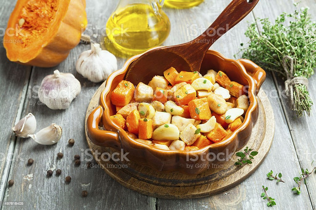 Chicken baked with pumpkin royalty-free stock photo
