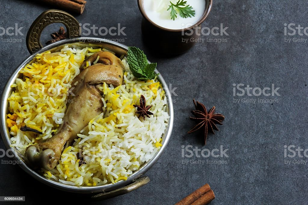 Chicken biryani served in a traditional Kadhai, selective focus stock photo