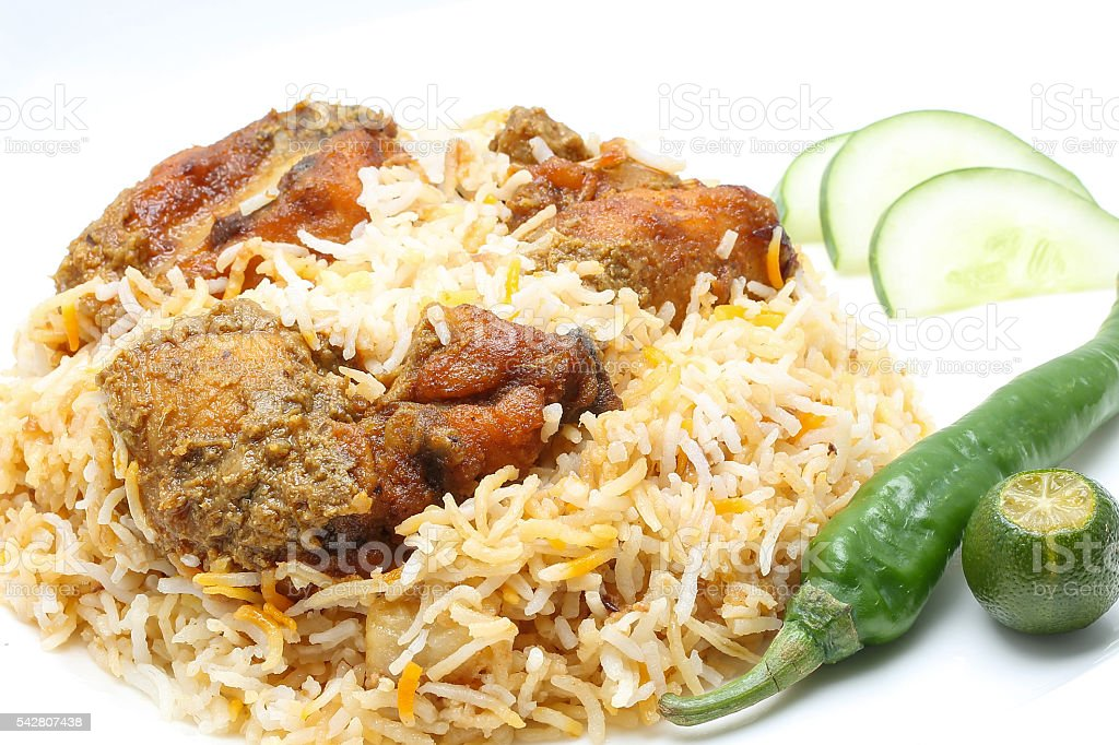Chicken Biryani with chili and lime stock photo