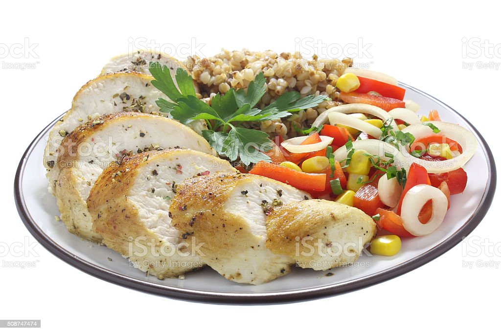 Chicken breast, buckwheat and salad stock photo