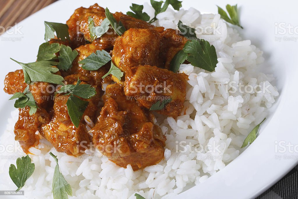 Chicken breast curry with rice on a white plate stock photo