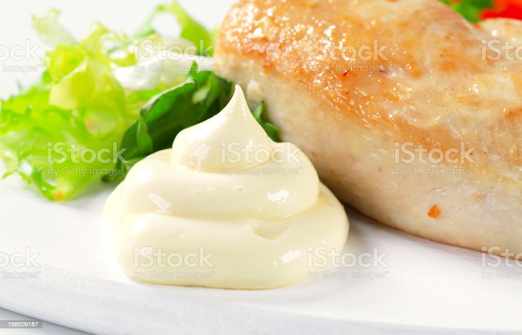 Chicken breast fillet with mayonnaise royalty-free stock photo