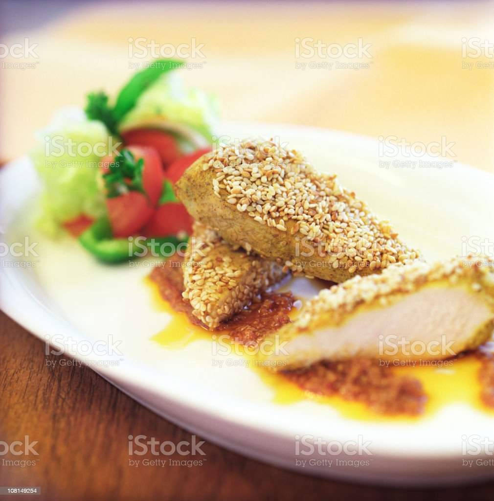 Chicken Breast Rolled in Sesame Seeds with Side Salad royalty-free stock photo