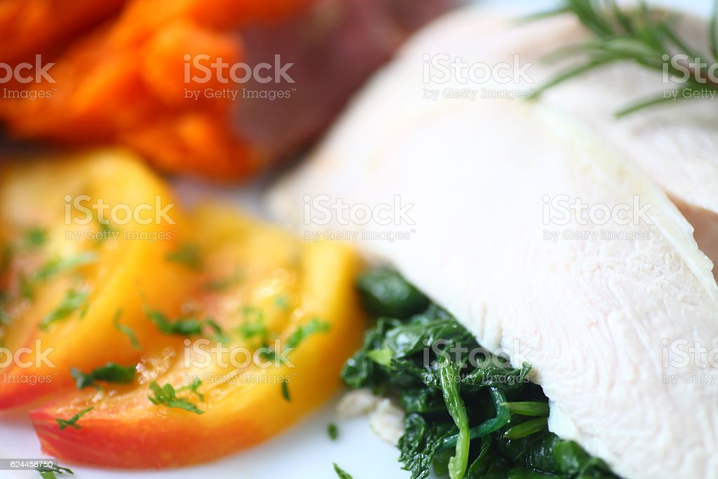 Chicken breast slices with tomato and kale stock photo