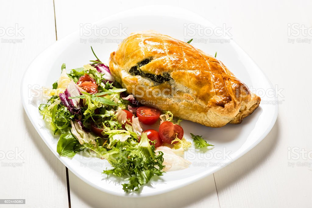 chicken breast stuffed spinach in puff pastry stock photo