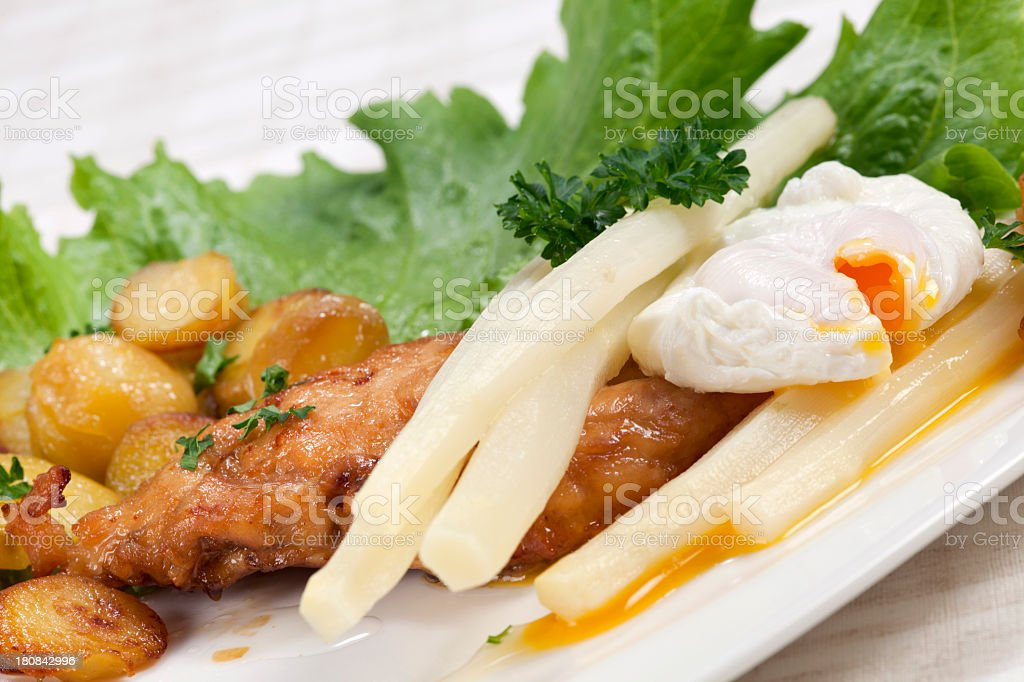 Chicken breast with asparagus and poached egg royalty-free stock photo
