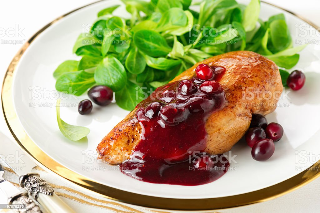 Chicken breast with cranberry sauce stock photo