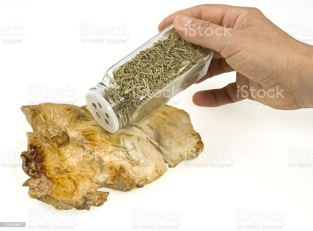 Chicken Breast with dried rosemary royalty-free stock photo