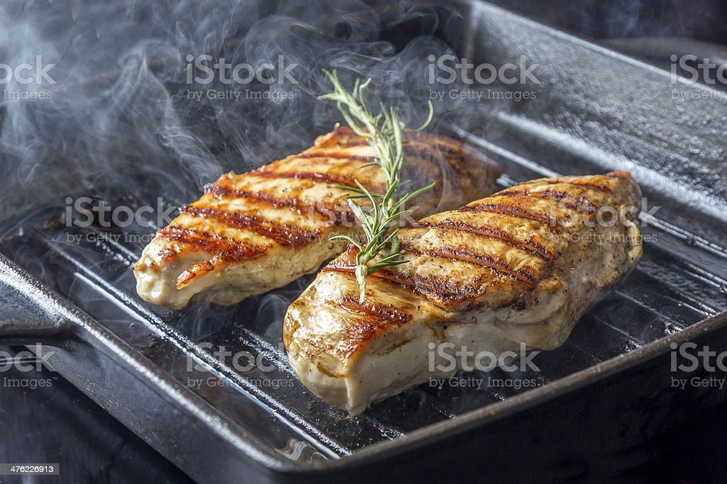 Chicken Breast with rosemary in pan stock photo