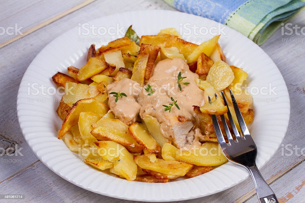 Chicken breasts in mushroom creamy sauce and home fried potatoes stock photo
