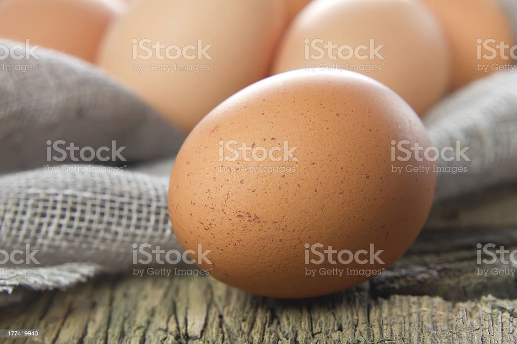 Chicken brown eggs on the wooden table royalty-free stock photo