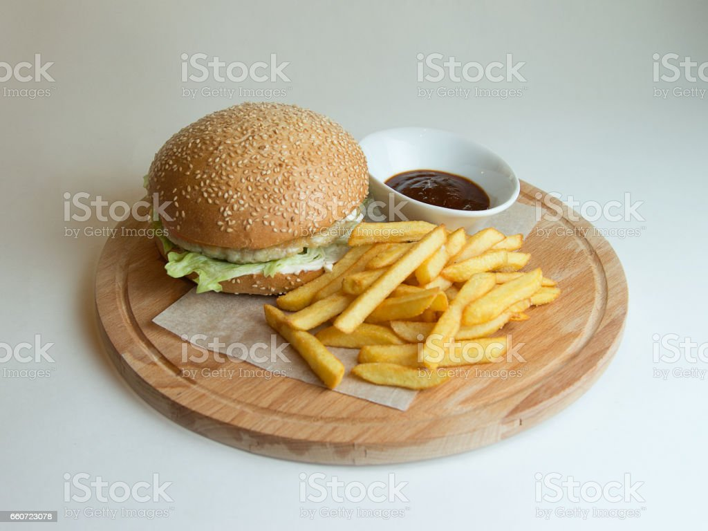 chicken Burger on a wooden Board stock photo