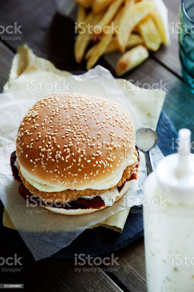 chicken burger with chips stock photo