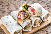Chicken burritos on the wooden background