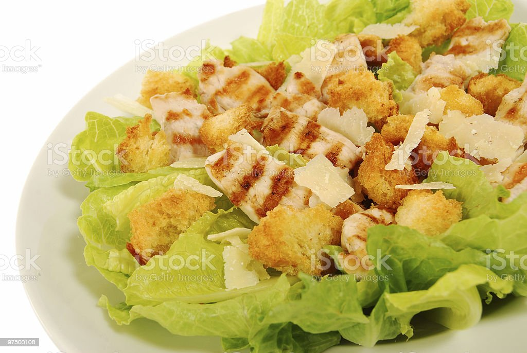 Chicken caesar salad on a white table stock photo