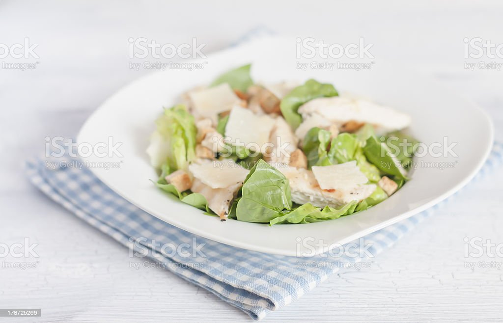 Chicken Caesar salad on white plate royalty-free stock photo