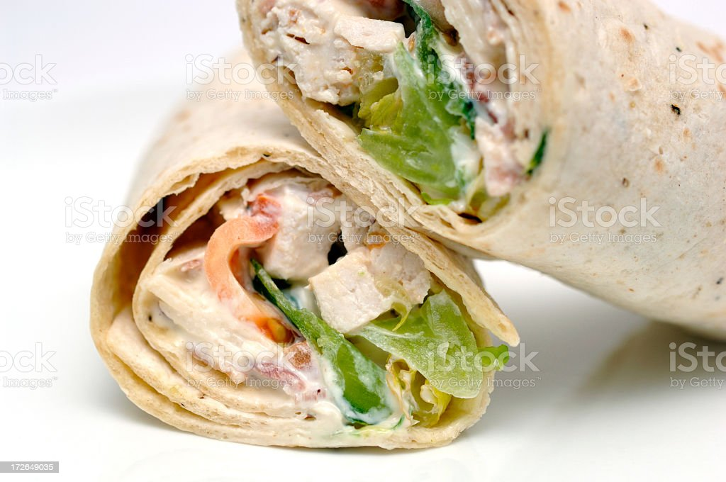 chicken caesar salad totilla wrap on a white plate royalty-free stock photo