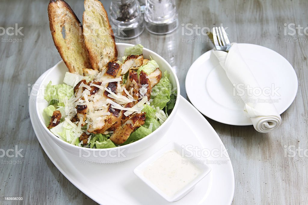 chicken ceasar salad with condiments royalty-free stock photo