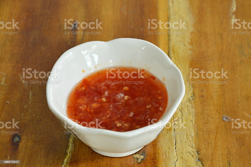 chicken chili sauce in cup on table stock photo