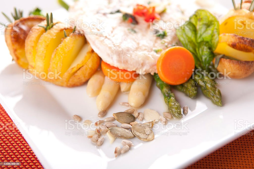 Chicken chop with roasted potatoes and asparagus stock photo