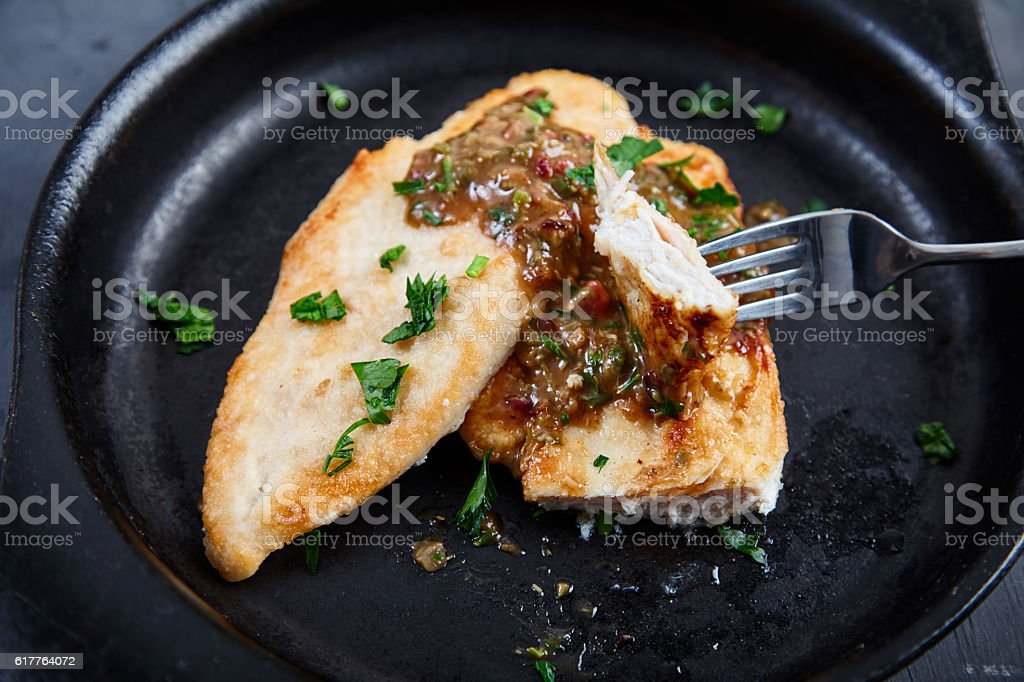 Chicken chops with sauce of cognac, broth, capers stock photo