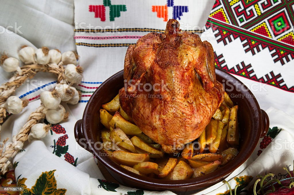 Chicken cooked in the oven on a ceramic base. stock photo