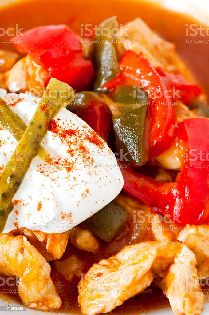 Chicken cooked with red and green peppers royalty-free stock photo