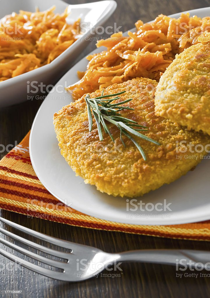 Chicken cordon bleu with grated carrots. royalty-free stock photo