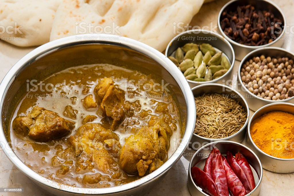 Chicken curry and spices stock photo