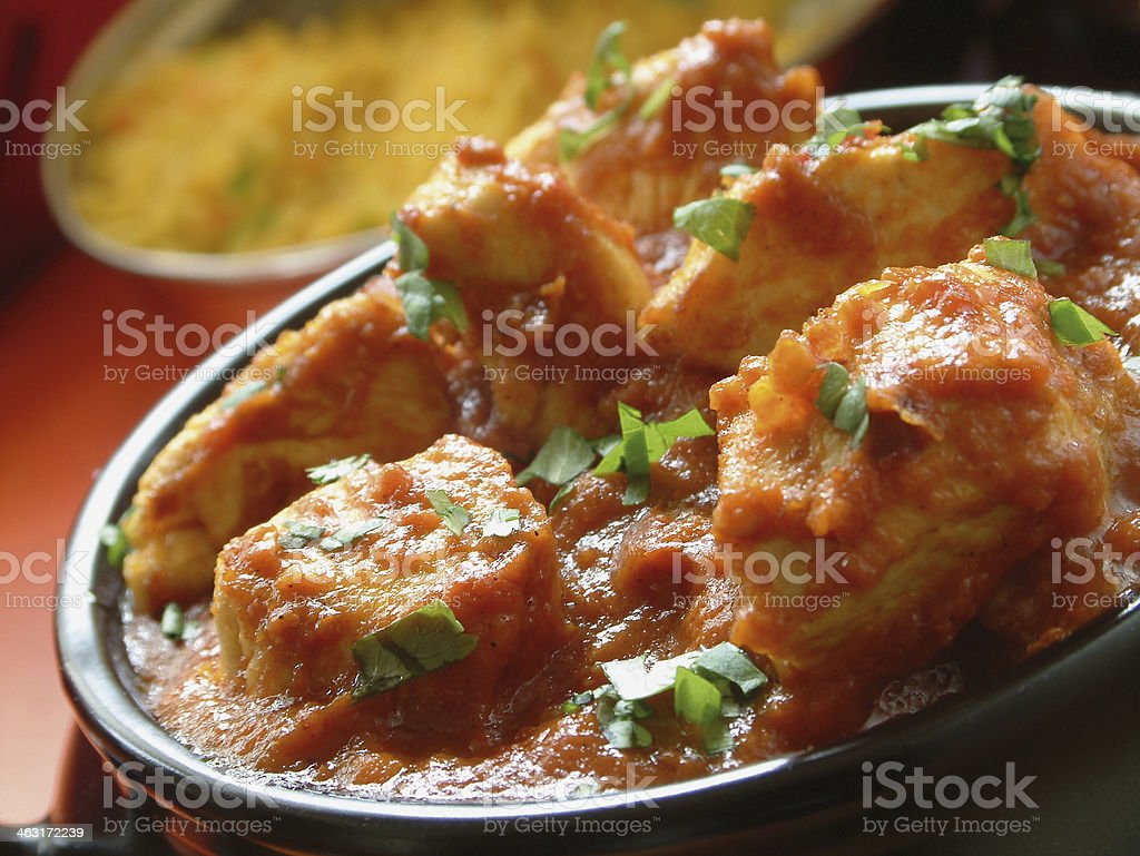 chicken curry in dish stock photo