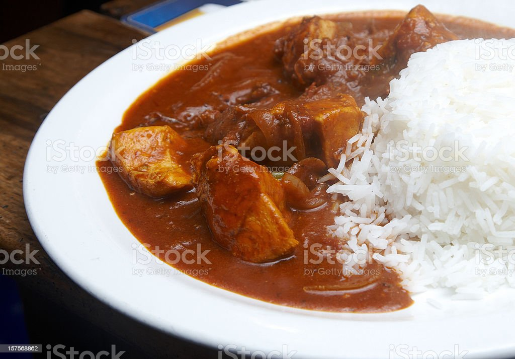 Chicken curry with boiled rice stock photo