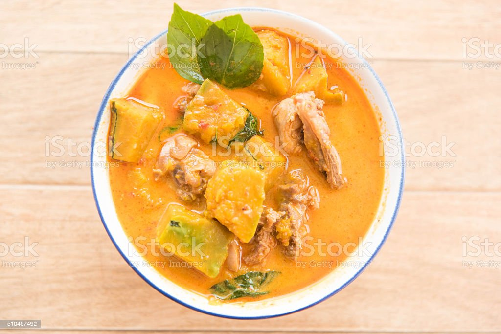 chicken curry with coconut milk and pumpkin,Thai style food stock photo