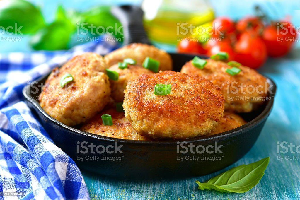 Chicken cutlests in a skillet. stock photo