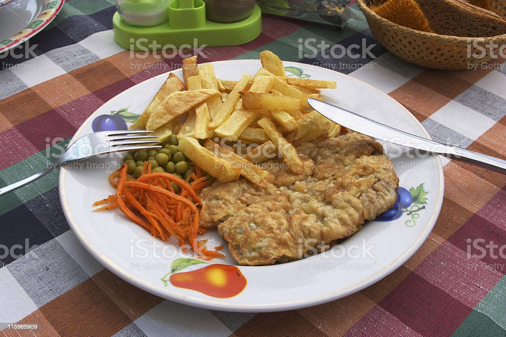 Chicken cutlet and french fries stock photo