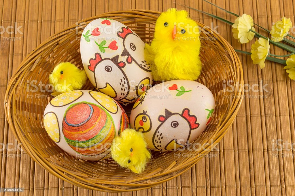Chicken decorated Easter eggs stock photo