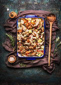 Chicken dish with vegetables and cooking spoon