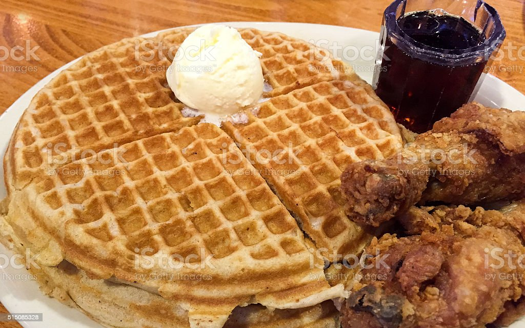 Chicken Drums with Waffles, Butter and Syrup stock photo