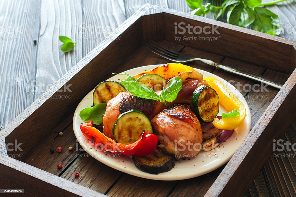 Chicken drumsticks roasted with vegetables stock photo