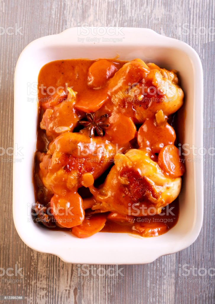 Chicken drumsticks with carrot stock photo