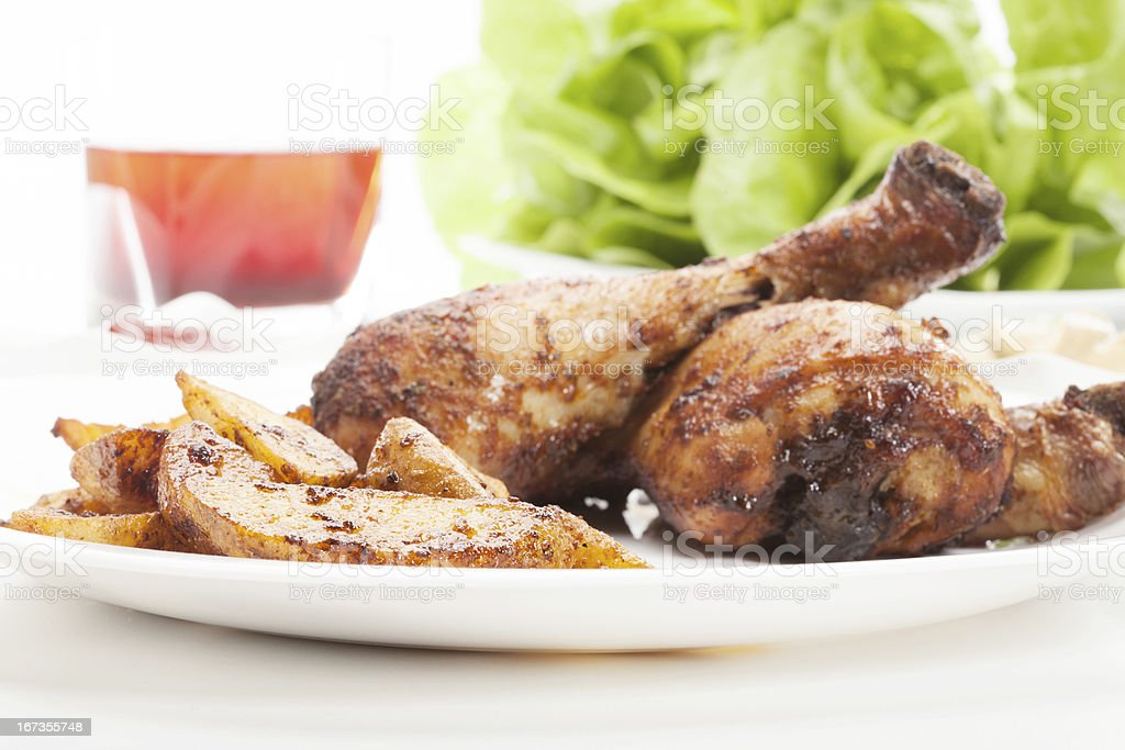Chicken drumsticks with prepared potatoes stock photo