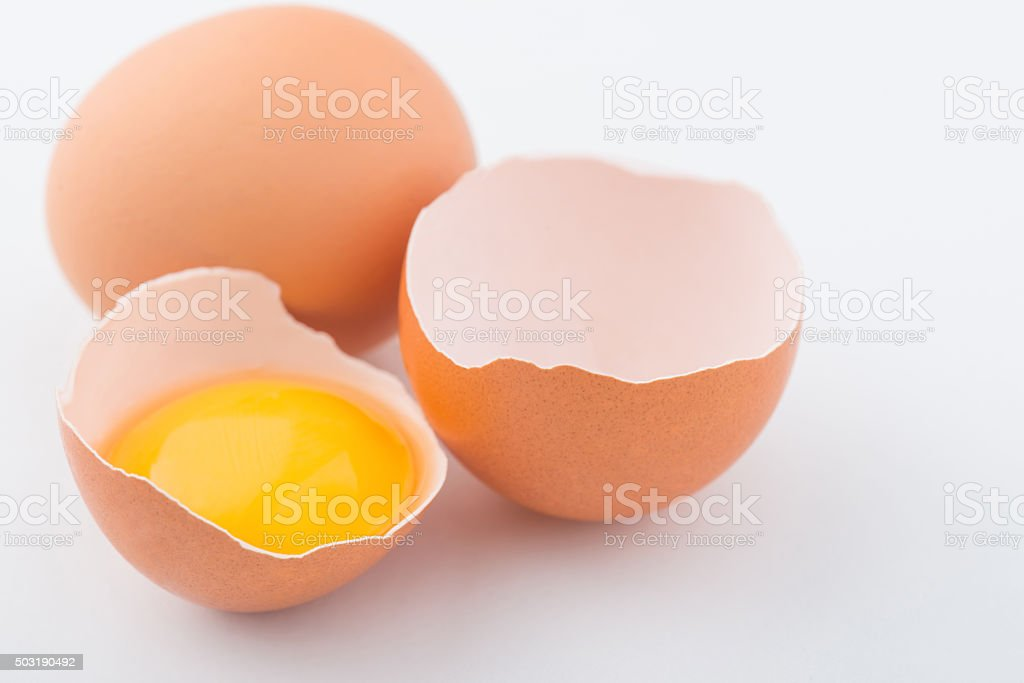 Chicken eggs are on white surface stock photo